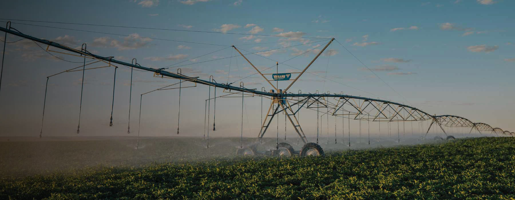 valley center pivot spraying water in field