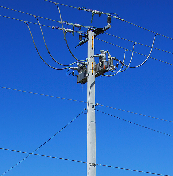 hybrid utility pole connected to transmission wires