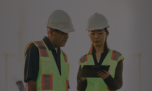 two workers looking at tablet