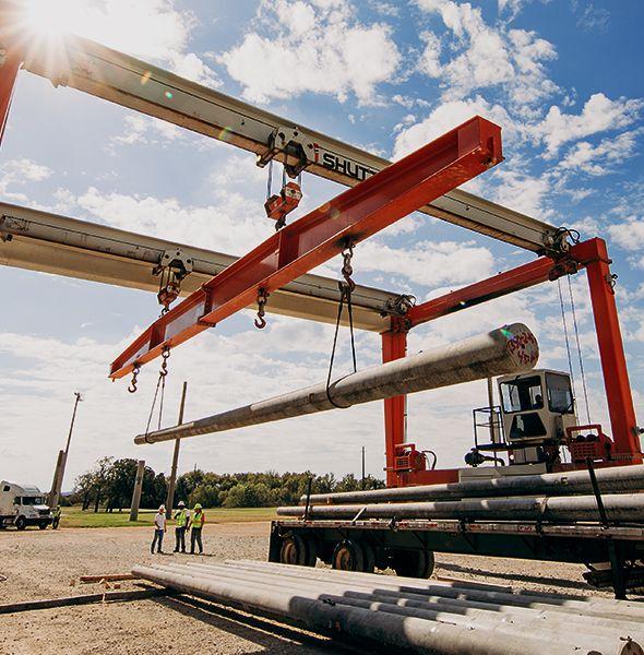 crane hoisting spun concrete pole